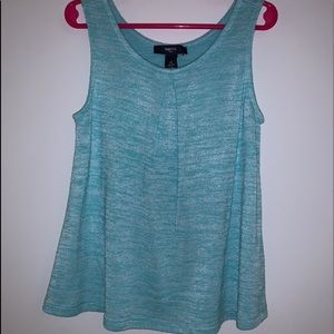 No sleeve shirt color turquoise.